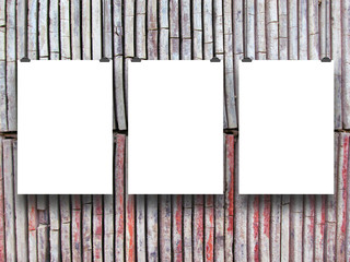 Three vertical frames with clips on clay tiles background