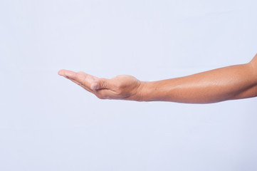 male hand holding on white background. Palm up