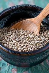 hemp seeds on wooden surface