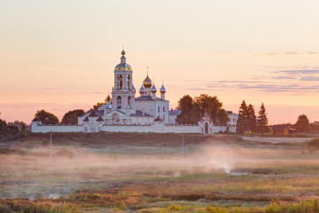 Village Pogost-Krest. Monastery of the Lord's Life-giving Cross at sunrise