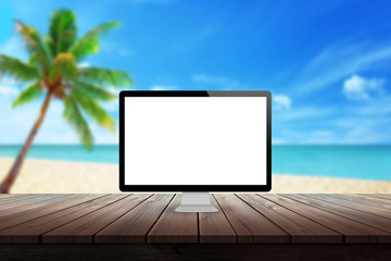 computer display on desk with beach palm tree and sea in the background mock up presentation