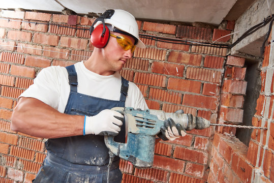 construction worker with drill perforator