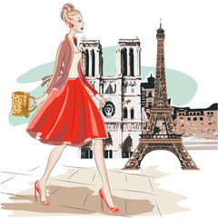 Fashion woman in red skirt walks around Paris near Eiffel Tower