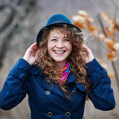 Curly hair beautiful young caucasian girl outdoors