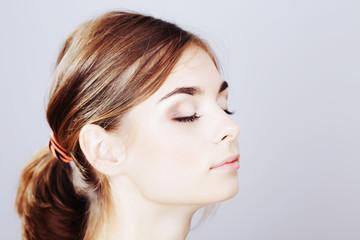 Teenager applying make-up by artist.