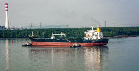 Tugboats assisting oil tanker