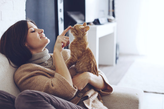 Woman resting with kitten