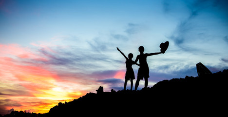 Boys play at sunset.