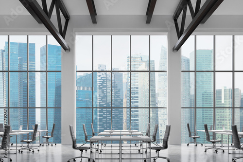 Modern workplaces in a modern bright clean interior of a loft style office huge windows