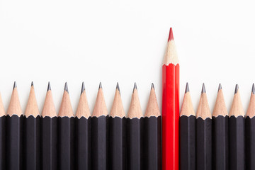 Red pencil standing out from crowd