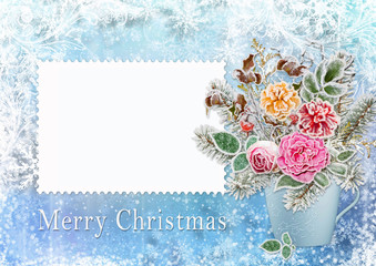 Christmas greeting card with a bouquet of flowers and branches with hoarfrost