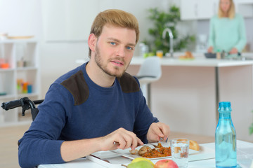 Man eating a meal at the dining table