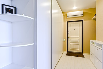 Fragment of interior apartment hallway and entrance door and air conditioning