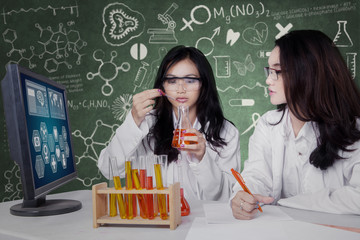 Beautiful scientists doing experiment