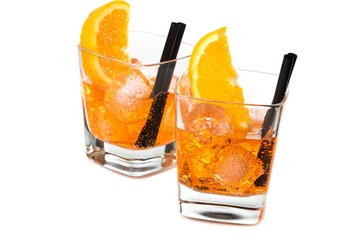 Fototapete - two glasses of spritz aperitif aperol cocktail with orange slices and ice cubes