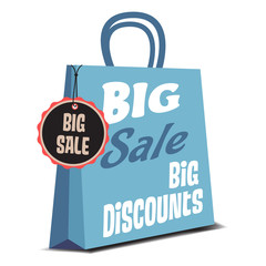 Isolated blue shopping bag with the text big sale, big discounts written on the bag