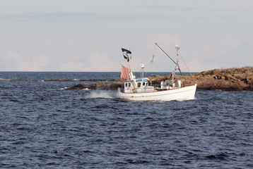 Small fishingboat in front of an island