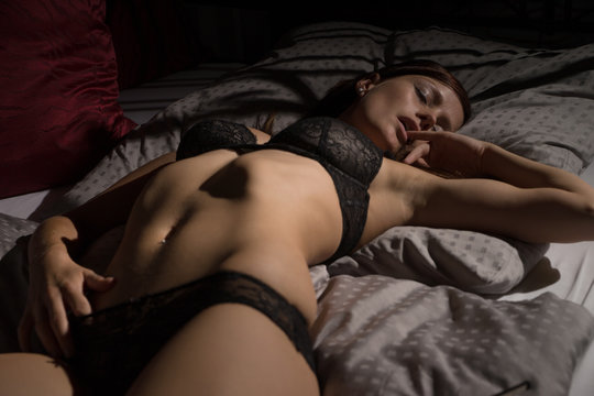 sexy Woman / sexy woman in underwear lying in bed