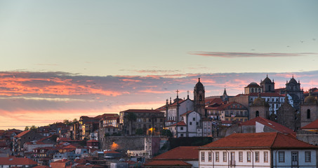 Porto city, Portugal October 17, 2013: Beautiful view of Old town of Porto in Portugal with nice sunset clouds