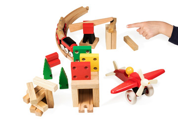 Child points to wooden toys