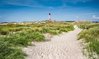 Dune landscape with lighthouse at North Sea
