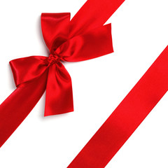 Red satin bow ribbon on white