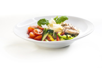 Salad with grilled chicken and vegetables on white background