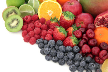 Juicy Fruit. Healthy mixed fresh fruit selection high in antioxidants, vitamin c and dietary fibre, with copy space.