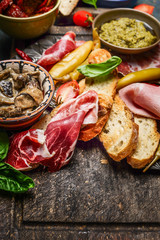 Italian smoked ham Prosciutto with crostini bread and specialties for antipasti