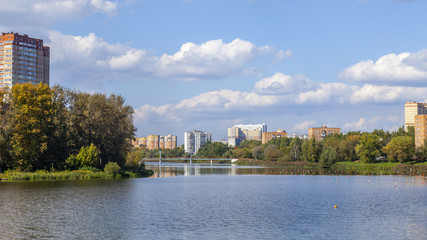 PUSHKINO, RUSSIA - on SEPTEMBER 15, 2015. Autumn landscape. Multystoried houses on the river bank of Serebryanka