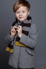 young boy in jacket  are posing in studio