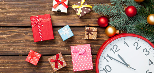 Gift box and clock with christmas baubles