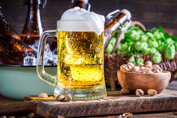Fresh and cold beer with nuts
