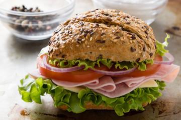 brown bun ham sandwich