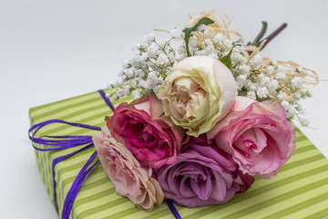 Romantic gift decorated with roses, closeup shot