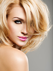 Portrait of  beautiful woman with blond hair.  bright fashion ma