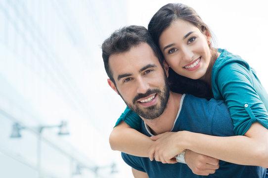 Young man piggyback her girlfriend