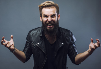 young attractive bearded hipster man gesturing emotional