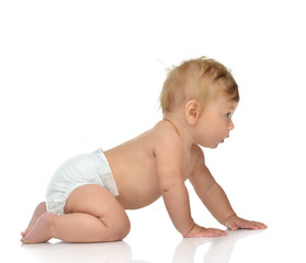 6 month infant child baby toddler sitting or crawling looking at