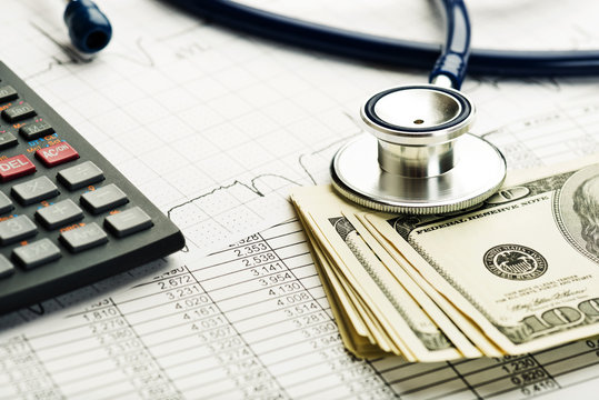 Health care costs. Stethoscope and calculator symbol for health