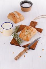 Ciabatta bread over rustic white wooden background