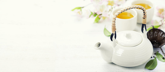 Chinese Tea Set and pink sakura blossom