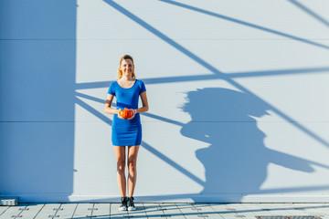 Girl with pumpkin make an interesting shadow