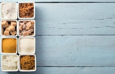 Eight kinds of sugarat left side of blue background