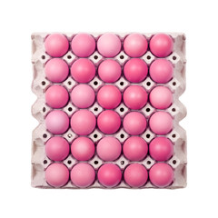 Pink eggs in paper tray