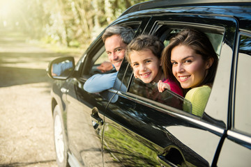 family leaves by car for the weekend