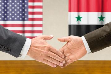 Vertreter der USA und Syriens reichen sich die Hand