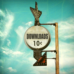 aged and worn vintage photo of downloads sign