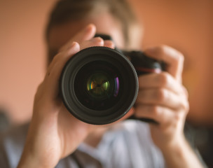 Photographer doing self portrait in a mirror. Vintage toning. Shallow depth of filed.