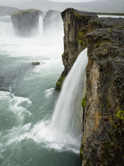 Selfoss waterfall, a cascade of water over a sheer cliff.